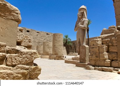 The ancient ruins of the Karnak temple in Africa and the statue of Pharaoh Ramses
