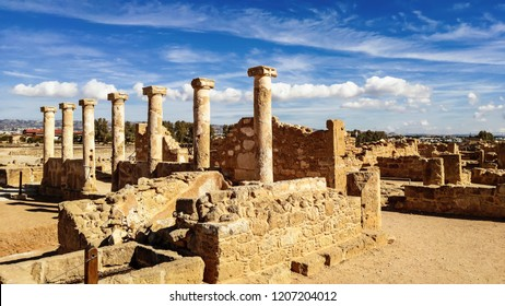 Ancient ruins of Kourion city near Pathos and Limassol, Cyprus. Row of columns under blue sky. Travel outdoor background
