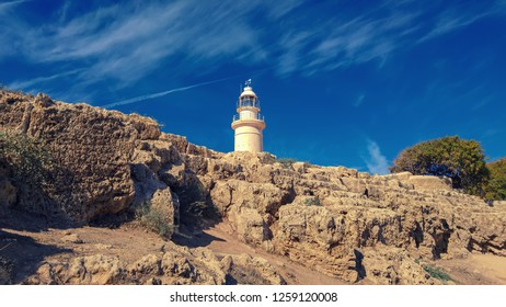 Ancient ruins of Kourion city near Pathos and Limassol, Cyprus. Lighthouse under the blue sky. Travel outdoor background