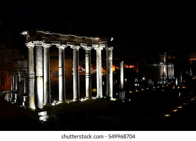 The ancient ruins of the Roman Forum in Rome, Italy at night; long exposition.