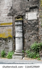 "Ancient ruins in Rome (Italy) - 1st Milestone of Via Appia (Appian Way), Translation on the plate  ""1st Milestone of Appian Way from Capitoline Hill""."