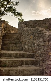 Ancient ruins stairs and wall old bricks. Vintage style. Up to the sky