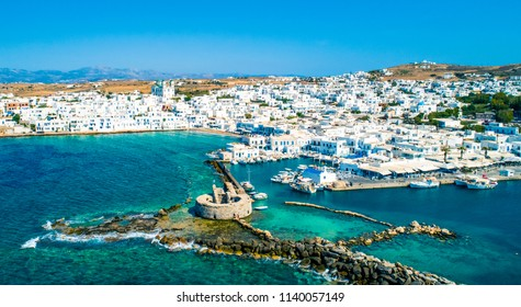Ancient ruins of Venetian castle in the harbor of Naoussa town, view from above, Paros island, Greece