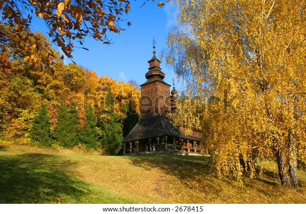 Ancient rural church in the autumn landscape