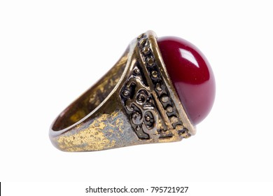 Ancient Rusted Golden Ring with Red Stone on White Background