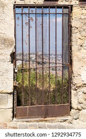 ancient rusty door with chains and padlock in Naples, Italy