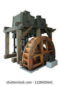 Ancient rusty old wooden water wheel driven machine isolated over white background