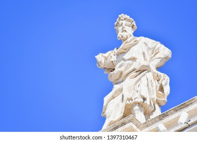 Ancient Saint Statue on Top of Bernini's Colonnade in Vatican City