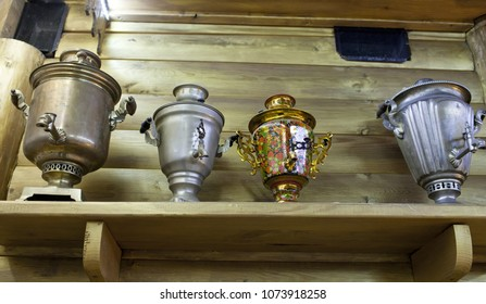 Ancient samovars on a wooden shelf