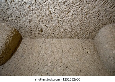 Ancient scratched surface of limestone wall in cave of Cappadocia Turkey. Structure of stone building inside cave. Natural limestone textured background. Grunge backdrop. Rough stone texture.