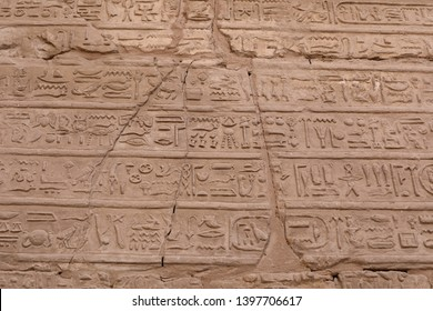 Ancient scripture on the wall at the temple of Karnak in Luxor, Egypt. Travel to the African continent for look of a UNESCO World Heritage Site.