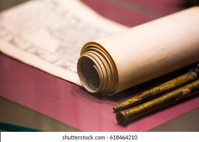 an ancient scroll on the table close-up