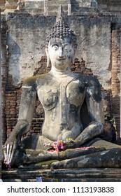 Ancient sculpture depicting Buddha figure in Sukhothai era, Thailand