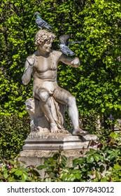 Ancient sculptures in a public Garden in courtyard of Palais-Royal Palace. Palais-Royal (1639, originally - Palais-Cardinal) was personal residence of Cardinal Richelieu. Paris. France.