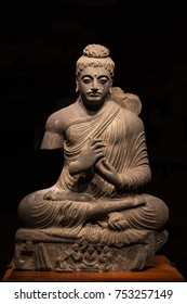 ancient seated Buddha schist statue image in 2nd-3rd century, kushan dynasty from Pakistan.