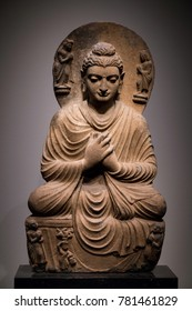 ancient seated Buddha schist statue image in 2nd-3rd century, Kushan dynasty from Gandhara, Pakistan.