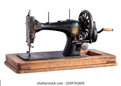 Ancient sewing machine isolated on white background.