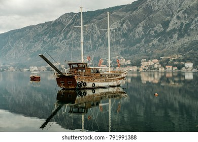 Ancient ship in Adriatic Sea gulf with mountains in Montenegro, Kotor