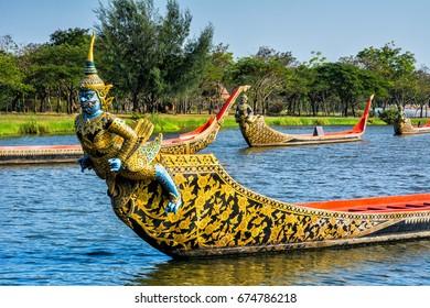Ancient Siam park, Royal Water-Course Procession, decorated wooden thai boats on pond closeup. Location: Ancient City, Mueang Boran, Samut Prakan Province, Bangkok, Thailand.