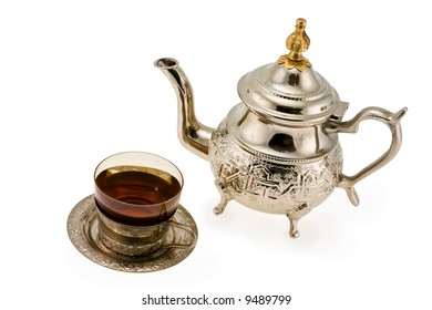 Ancient silver teapot and cup to tea