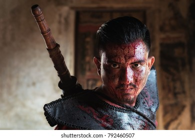 Ancient soldiers have blood on the face.