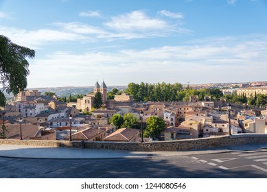 ancient spanish city Toledo in sunset light, view from old town