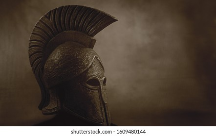 Ancient Spartan (Greek) warrior helmet on a grunge background with copyspace for text. Suitable for TV documentaries, history information etc.