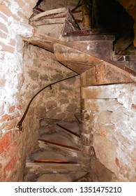 Ancient spiral staircase in the medieval castle leading to the tower.