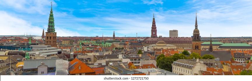 Ancient spires dot the skyline of Copenhagen, Denmark in summertime