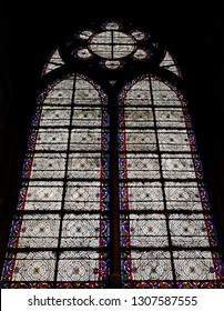 An ancient stained glass window in the Notre Dame Cathedral. An ancient stained glass window in the Notre Dame Cathedral. Stained glass windows inside the Notre Dame Cathedral.