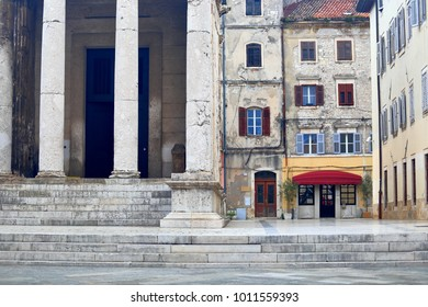 Ancient stairs and columns of a Roman temple and medieval buildings in Pula, Croatia
