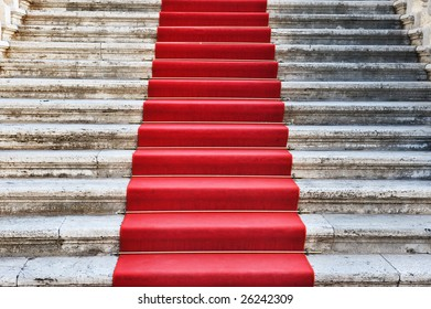 Ancient stairs covered with red carpet