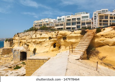 ancient stairs in the Fort Tigne (Sliema) fortress (Sliema, Maltese islands) and new apartment buildings 2013