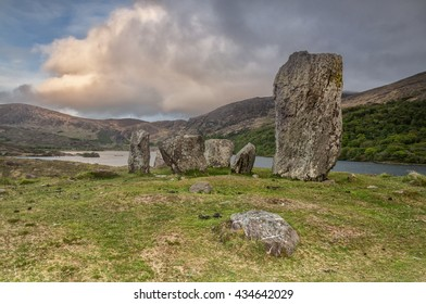 Ancient Standing Stones Set Beside A Lake