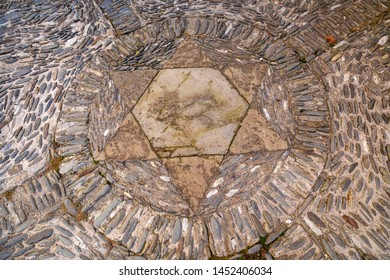 Ancient Star of David in pavement stone.
