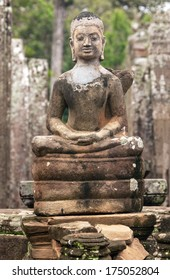 Ancient statue of Buddha in the temple of Angkor Wat in Cambodia. Canon 5D Mk II.
