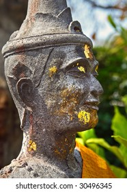 ancient statue face in thailand