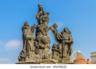 Ancient Statue on Charles Bridge (Karluv most) - famous historic bridge in Prague, Czech Republic.