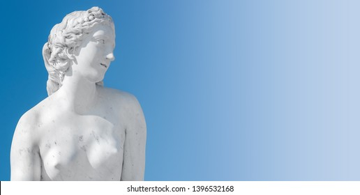 Ancient statue of sensual Italian renaissance era woman with long neck and curly hairs at blue sky gradient background, Potsdam, Germany, details, closeup