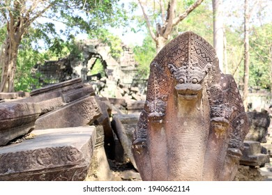 Ancient statues of multi-headed serpents or nagas and ruin of Koh Ker complex, Cambodia, Indochina. UNESCO world heritage site - Shutterstock ID 1940662114