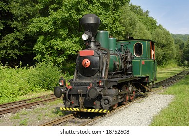 Ancient steam locomotive on a vintage railroad
