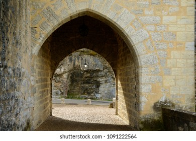 Ancient stone arch gateway at medieval Valentre bridge in Cahors, France
