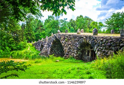 Ancient stone bridge in deep forest landscape. Stone bridge in deep forest scene. Medieval stone bridge view