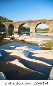 ancient stone bridge on a river in salamanca spain