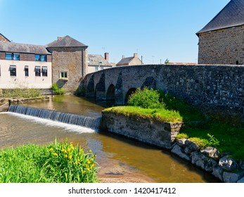 The ancient stone bridge over the River Selune in Ducey-les-Cheris, France.