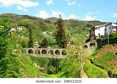 ancient stone bridge in the Tuscan village of Barga in Lucca. The village is certified one of the most beautiful villages in Italy