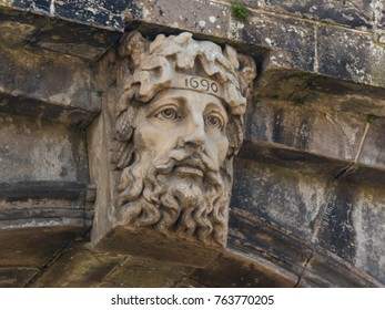 The ancient stone carving of the River God dating back to 1690 on the Bishop's Gate in Londonderry in Northern Ireland