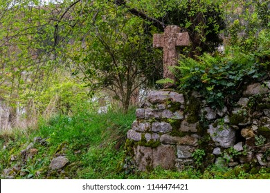 Ancient stone cross in Cue. Asturias, Spain.