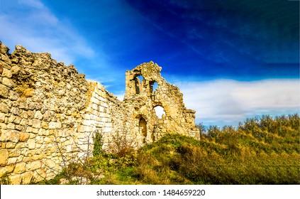 Ancient stone fortress wall ruins. Ruins wall in nature. Fortress wall ruins scene. Ancient fortrees wall ruin view
