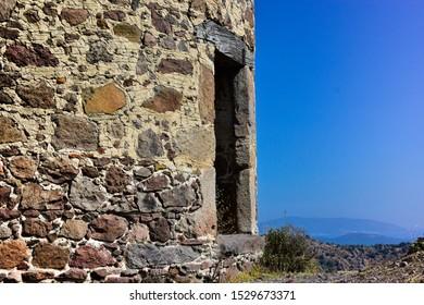 an ancient stone grinder at an aegean town